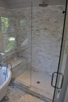 glass shower design with carrara marble subway tile shower surround, marble ...