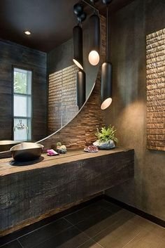 I love the look of dark bathrooms with wood and brushed aluminum accents.