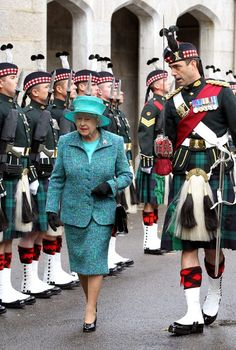 Queen Elizabeth II arrives to a welcome by the Argyll and Sutherland Highlanders, who will be guarding her as she begins her summer holiday at Balmoral Castle.  August 2011.