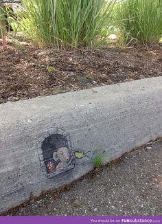 Street art...That is so cute...I'd love some little windows on the bottom of my brick wall!