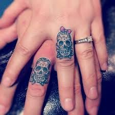 Want a ring tattoo design inked on your finger? Pick a wedding ring tattoo or a cool ring finger tattoo from the rarest ring tattoo designs. Skull Finger Tattoos, Skull Couple Tattoo, Finger Tattoos For Couples, Cute Couple Tattoos, Sugar Skull Tattoos, Ring Tattoos, Tattoo Finger, Tatoos, Tattooed Couples