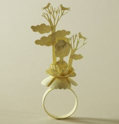 Artist Elsa Mora made this ring — and it's made entirely out of paper! Her website is filled with simply mesmerizing papercraft work.