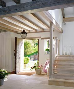 Gorgeous light oak wood staircase and beams for a bright, airy, natural and neutral entryway. Simply stunning modern farmhouse-style home! Style At Home, Modern Farmhouse, Farmhouse Style, Farmhouse Kitchens, Modern Rustic, Farmhouse Decor, Interior And Exterior, Interior Design, Exposed Beams