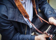 The Presidio camera strap is handcrafted with top grain leather and a waxed canvas neckline that is padded with soft neoprene. Two sets of chrome buckles allow for adjusting the length, while custom rivets provide an extra style point. The Presidio camera strap is most comfortably worn crossbody and is designed for use with camera kits weighing up to six pounds. Handcrafted with premium waxed canvas and leather Neoprene-padded neckline Chrome hardware accents Designed for camera kits…