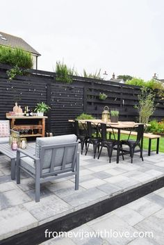 Garden Patio Area makeover, custom built black wooden privacy screen, grey slabbed area. Garden Slabs, Fence Lighting, Large Planters, Amazing Spaces, Outdoor Furniture Sets, Outdoor Decor, Diy Patio, Modern Spaces, Outdoor Cushions