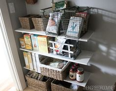 I really like this pantry!......woven baskets, especially........kitchen pantry organization
