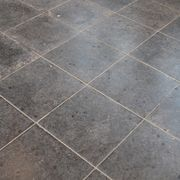 If a tile floor is in good condition but is a color that does not go with the rest of your decor, it is possible to change its color. Paints containing a urethane resin can be used to safely and permanently change the color of floor tiles. For the best results the tiles must be clean and in good condition with no cracks. While the grout lines can...