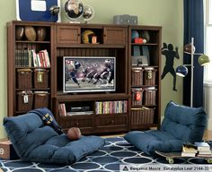 """Easy to maintain order and cleanliness in this space.  In addition to some regular couch seating, these """"flip out floor loungers"""" add some additional, casual seating that can easily be moved around the space.  A hidden hinge allows you to adjust these loungers in 4 different positions (including totally flat!)  http://www.pbteen.com/products/flip-floor-lounger/?pkey=cflip-floor-lounge  PB Teen"""
