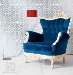show stopping gorgeous chair with peacock fabric and white painted trim