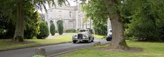 Our wedding cars making their way down Luttrellstown Castle Resort's driveway post wedding ceremony