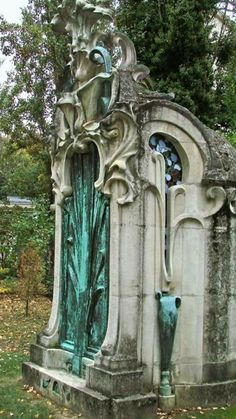 """TOMB Nancy France : Jules Nathan, art critic from Nancy, built this tomb, decorated with stained glass with floral decoration of Henri Carot and surmounted by a Lys Enamelled Stoneware of Alexandre Bigot (1862-1927). This is one of the earliest examples of funerary art nouveau architecture to Nancy."""""""