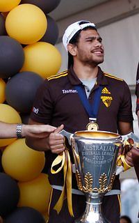 Cyril Rioli is all smiles after the Hawks' Grand Final win