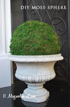 How to make a faux moss sphere--an easy way to add some green back in the house after the holiday greenery is packed away.  From 11 Magnolia Lane.