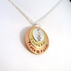 #uu - I love personalizing Unitarian Universalist chalice jewelry. I love the lotus theme in this mixed metal stack pendant. Purchase it here: http://www.crowstealsfire.com/product/mixed-metal-triple-disk-uu-chalice-family-necklace