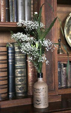 Old gin bottles as alternative wedding flower vase www.hommehouse.co.uk