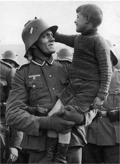 A German soldier says farewell to his son before leaving for the front, circa 1940, Germany.