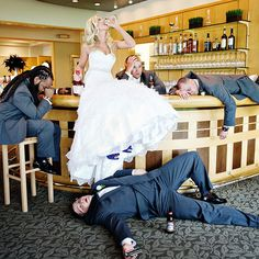 This bride proudly drank the groomsmen under the table.