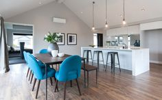 high ceiling in living area Living Area, Colorful Chairs, Home, Dining, Dining Table, Table, Show Home, Conference Room Table, High Ceiling