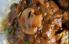 Perfectly tender beef patties simmered in the crock… Slow Cooker Salisbury Steak! Perfectly tender beef patties simmered in the crock pot in a rich brown gravy with mushrooms! This is a family favorite! Crockpot Dishes, Crock Pot Slow Cooker, Beef Dishes, Slow Cooker Recipes, Crockpot Recipes, Cooking Recipes, Quick Recipes, Saulsberry Steak Recipes, Popular Recipes