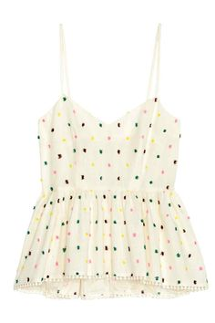 Peplum strappy top: Peplum strappy top in an airy cotton blend with woven, fringed spots, a V-neck, narrow shoulder straps and a concealed zip at the back. The top is very wide at the hem with a decorative trim and slightly longer at the back.