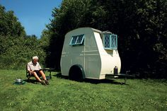 Frank's caravan is thought to have been made from a section of fuselage from a second world war aircraft mounted on a car chassis and has been fitted with a felt roof, dinky porch and bay window. Unsurprisingly it attracts a lot of attention on the road.