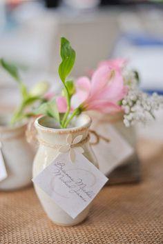 the ceramic pot (with a simple floral arrangement) is the favor