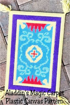 Take a magic carpet ride at your Aladdin party or Disney princess party with this plastic canvas pattern perfect for your party decorations. This pattern is an easy sew with basic plastic canvas stitches and is super cute and fun for decorating anywhere. Aladdin Birthday Party, Aladdin Party, Diy Banner, Pennant Banners, Plastic Canvas Stitches, Plastic Canvas Patterns, Aladdin Magic Carpet, Hama Beads Disney, Disney Canvas