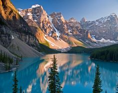 Moraine Lake is a glacially-fed lake in Banff National Park, 14 kilometres outside the Village of Lake Louise, Alberta, Canada. It is situated in the Valley of the Ten Peaks, at an elevation of approximately 6,183 feet.