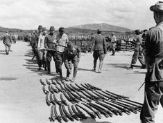 A long line of Japanese officers wait to surrender their swords to the 25th Indian Division at Kuala Lumpur.