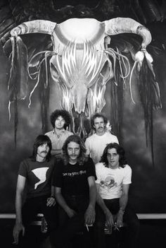 The Eagles in front of their Album Art