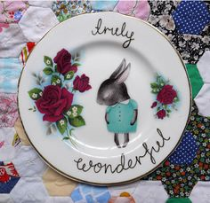 shy bunny painted on vintage plate.