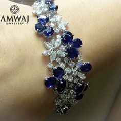 The detailed combination and harmony of blue sapphire and diamonds is just simply exquisite. #amwaj_jewellery