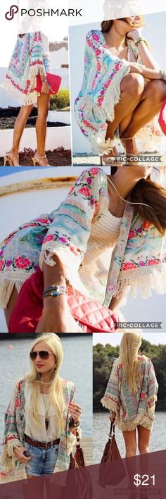 BOGO50% OFF! 💠NWT FLORAL KIMONO Vibrant floral kimono bursting with warm colors and fringe. Also great as a swim cover up!💠BOGO 50% OFF! Buy 1 item and get 2nd item of equal or less price at 50% OFF! Ask for a BOGO 50 bundle listing for your selections!                                                               💠FREE GIFT with purchase over $10!            💠TAGS: swim cover up, kimono, floral kimono, fringe kimono Sweaters Cardigans