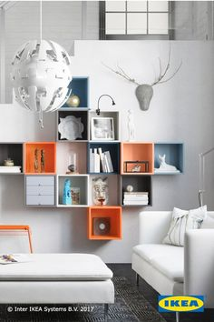 Living room design tip: Storage should help you stay organized while also showcasing your favorite seasonal décor. The IKEA EKET series is perfect for families who want to display different décor every season.