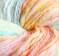 These yarns are dyed with a rainbow variegated effect that would look amazing striped in with a solid shade. This yarn is 100% cotton. Each skein is 50g (140 meters), and is a DK weight with a subtle thick and thin texture that would be great for openwork projects or shawls.
