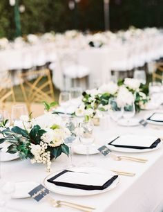 Elegant black, gold and greenery table decor: http://www.stylemepretty.com/2017/05/23/lush-palm-springs-wedding-at-the-parker/ Photography: Sally Pinera - http://sallypinera.com/