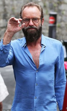 Rugged: A heavily-bearded Sting cut a rugged appearance as he arrived in France on Tuesday...