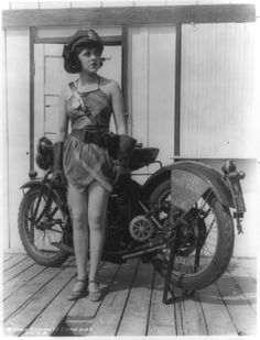 Posing as a Motorcycle Cop -- American silent-screen starlet Elsie Tarron began her professional career as a Mack Sennett Bathing Beauty