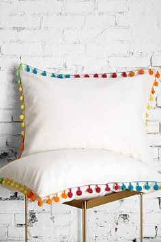 http://www.urbanoutfitters.com/urban/catalog/productdetail.jsp?id=28375202 Want to make!!! @white666witch This should be easy right? Plain white or cream pillowcase (well cushion case) and adding the trim, right? :p