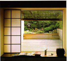 A Japanese Touch for your Home - love the way the shoji screens slide open to make a seamless indoor/outdoor connection