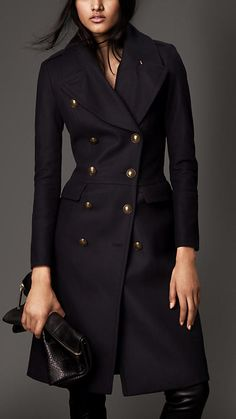 Love this Burberry military style coat! The cut is very flattering and defines the waist (a trait I love), and the gold-tone hardware and double-breasted features really finish out the piece.