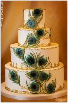 #peacock #wedding  Rich vibrant hues of blues and greens are amazing on this peacock wedding cake