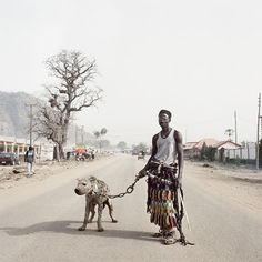 By Pieter Hugo.  Source: http://www.juxtapoz.com/current/the-hyena-and-other-men-and-other-photographs-by-pieter-hugo