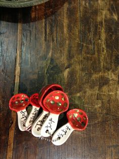Gold lady bug, mushroom-like measuring spoons. #anthrofav