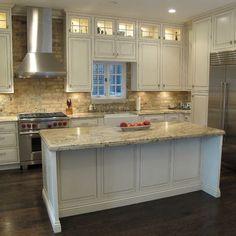 kitchen brick backsplash, high-end appliances w/ large functional island.
