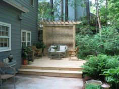 A low deck designed to add patio space over a swampy area of the yard. The custom lattice screen hides an old railroad tie retaining wall. Heather Moll-Dunn Landscape and Garden Designer