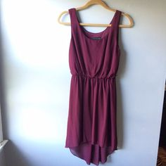 Maroon high-low dress Simple high low dress, super flattering and versatile; can be dressed up or down. Worn for one event, and has been sitting in my closet ever since... Just don't have an occasion to wear it! City Triangles Dresses High Low
