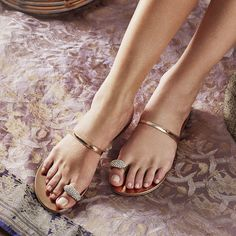Updated with mirrored leather insoles to reflect the patent strap and shining crystals, these Ring sandals will elevate summer looks. The new rose gold tone is primed for the sunshine.