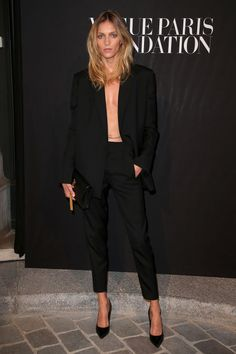 Anja Rubik wore a Saint Laurent suit to an event in Paris this week. In true supermodel style, she rocked it without a shirt but with a belly chain instead. Tempted to try the double-sided tape look? Us too.