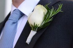 DIY Boutonnieres Hobby Lobby/Walmart fake flowers Use Ribbons/hot glue for the pin to go through